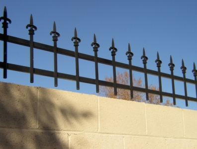 Security Fencing A Nice Topper For A Masonry Wall